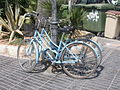 Blue bicycles chained together Sitges.jpg