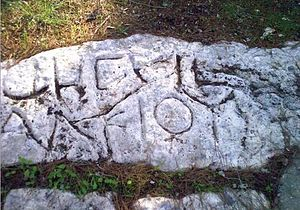 Gezer - Boundary inscription from Hellenistic Gezer, in Aramaic (top) and Greek (bottom)