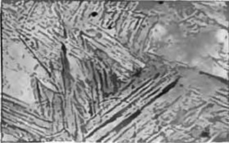 Tempering (metallurgy) - Photomicrograph of martensite, a very hard microstructure formed when steel is quenched. Tempering reduces the hardness in the martensite by transforming it into various forms of tempered martensite.