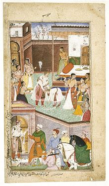 In the top, central figure of a young Chirakari touching the feet of a middle-aged Gautma, both dressed in royal Mughal clothes. Numerous royal ladies surround them. In the bottom of the painting, outside the door are royal men with horses.