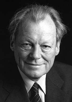 Black-and-white portrait photograph of Willy Brandt in a suit and tie