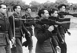 Milice - Members of the Milice, armed with captured British Bren guns and No. 4 Lee–Enfield rifles