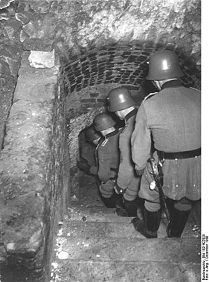 "Lublin Ghetto - The German Order Police from Orpo descending to the cellars on a ""Jew-hunt"", Lublin, December 1940"