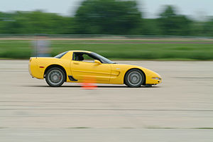 A Corvette Z06 at an autocross event. Note the distinctive black brake duct in front of the rear wheel.