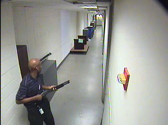 Murder - Aaron Alexis holding a shotgun during his rampage.