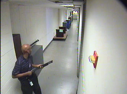 Aaron Alexis holding a shotgun during his rampage. CCTV 1 of Aaron Alexis in building 197.jpg