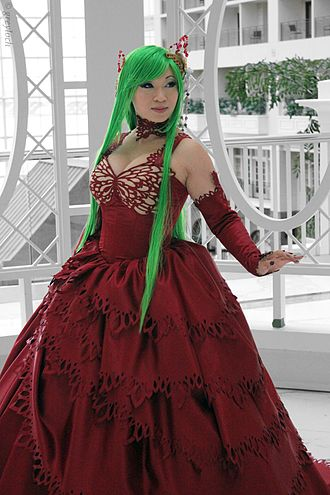 C.C. (Code Geass) - Famous cosplay artist Yaya Han dressed as C.C. in one of the character's later outfits in the show.