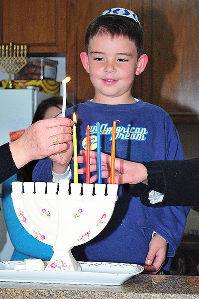 File:CHILD LIGHTING HANUKA CANDLES.jpg