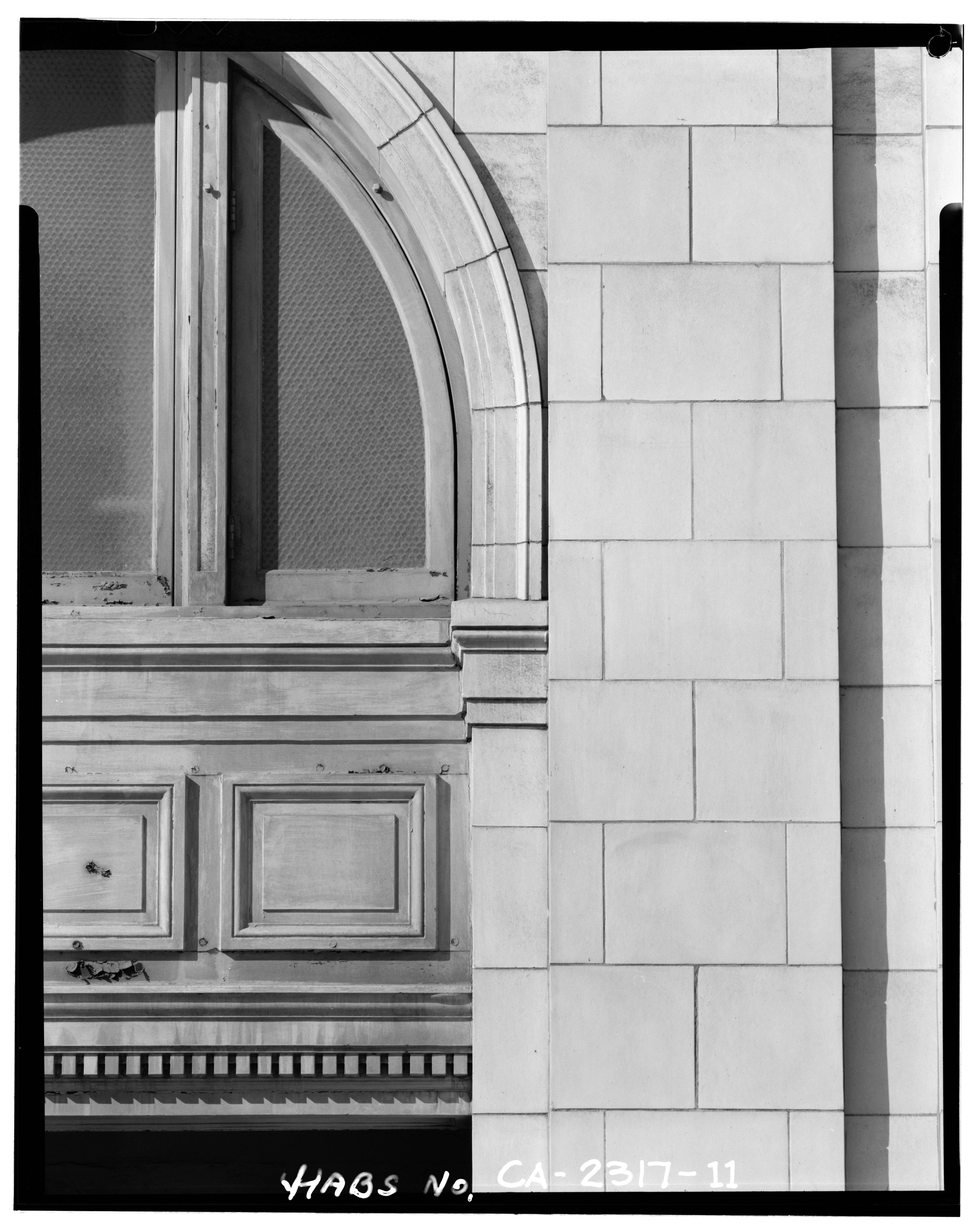 Front Elevation Panels : File close up view of arched nd floor window and cast