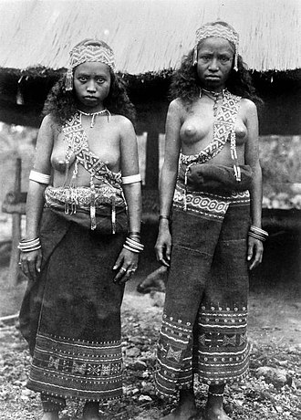 Abui people - Two women in dance outfit from Worbain, southeast of Alor Island.