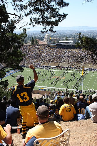 Fans atop Tightwad Hill watch the Cal Band, with views of the stadium and the San Francisco Bay. Cal Football From Tightwad Hill - Flickr - Joe Parks.jpg