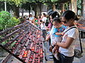 Candle Lighting for Prayer at Sto. Nino Church, Cebu Philippines.jpg