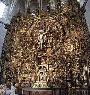 Retablo mayor de la Cartuja de Miraflores (Burgos). En el medallón central, Dios Padre y el Espíritu Santo (ambos con forma humana) sostienen los extremos del travesaño de la cruz.