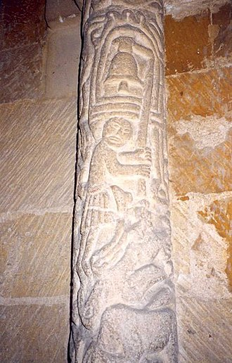 Stoke Dry - Carving of a bellringer on shaft to chancel arch, St Andrew's Church