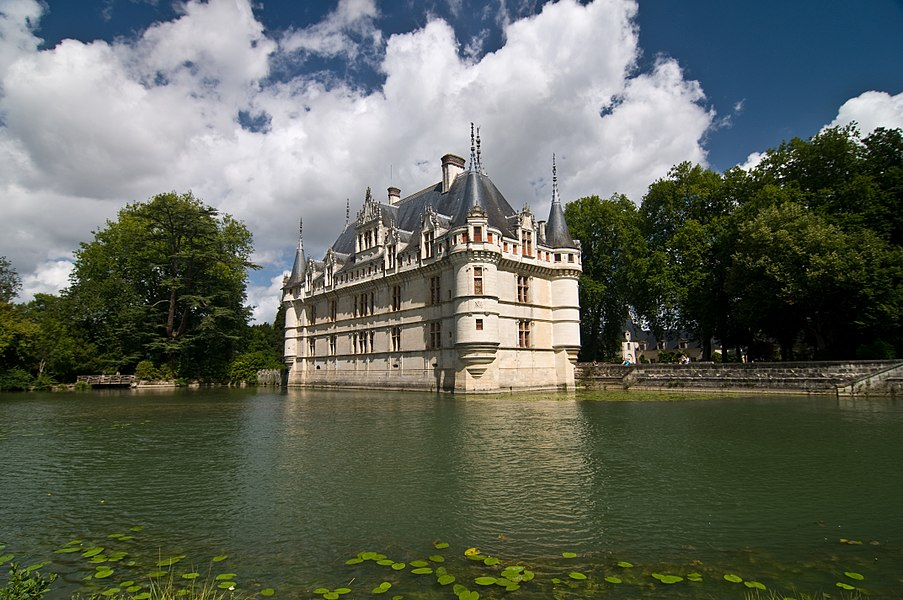 The château of Azay-le-Rideau was built from 1518 to 1527, one of the earliest French Renaissance châteaux. Built on an island in the Indre River, its foundations rise straight out of the water.  History of the château  Gilles Berthelot, state treasurer of François I and mayor of Tours, began building on this already-fortified site, that was partly his wife's inheritance. However, it was she, Philippe Lesbahy, who directed the course of the works, including the novel idea of a central staircase (escalier d'honneur) that is Azay's greatest innovation. When Berthelot was suspected of collusion in embezzlement he was forced to flee from incomplete Azay-le-Rideau in 1528; he never saw the château again. Instead, the king confiscated the property and gave it as a reward to one of his high-ranking soldiers.  Over the centuries, it changed hands several times until the early part of the twentieth century, when it was purchased by the French government and restored. The interior was completely refurbished with a collection of Renaissance pieces. Today, the château is open to public visits.  Building style  The big papa proportions and the sculptural decorations of Azay are Italianate, in the new antique taste, but the bastion corners capped by pointed cones, the vertical stacks of grouped windows separated by emphatic horizontal string courses, and the high sloped slate roof are unmistakably French. The playful fortifications and the medieval donjon towers gave an air of traditional nobility to the king's newly-ennobled treasurer. The central staircase is the main feature a visitor meets with upon entering. It is embodied within the building, rather than rising helically, partly embedded in the wall and visible from outside in the French way, a feature that is familiar at the Château de Blois.  The sculptural details at Azay are particularly remarkable. On the ground floor, fluted pilasters on high bases support the salamander and the ermine, emblems of François I and Claud