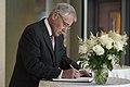Chuck Hagel signs condolence book MH17 (1).jpg