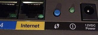 Wi-Fi Protected Setup - The WPS push button (center, blue) on a wireless router showing the symbol defined by the Wi-Fi Alliance for this function. This statement works for WPS users.