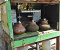 Clay Pots in Wooden Shrine (8394363934).jpg
