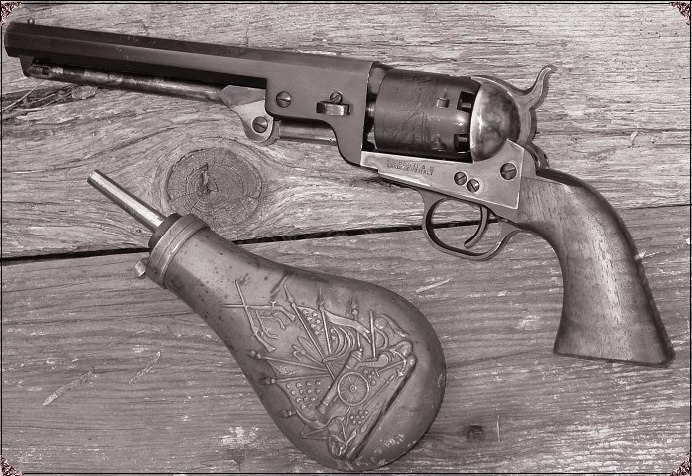 Colt 1851 Navy with powder flask.