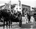 Communist election campaigners in Karol Bagh, a suburban area of Delhi, make use of tonga in 1952.jpg
