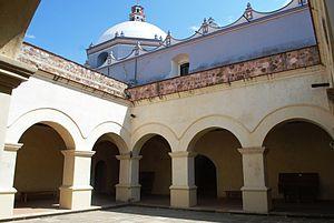 Ocotlán de Morelos - Courtyard of monastery with church behind