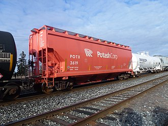 Potash - A covered hopper car in a Canadian train for shipping potash by rail.