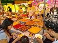 Cusco Peru- Plaza Tupac Amaru- trying pastries at a booth.jpg