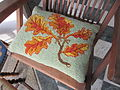 Cushion with rug hooked front with beach leaves.jpg