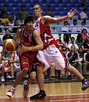 Cyrus Baguio - Cyrus Baguio breaking the defense of Rich Alvarez.
