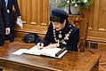 Dame Patsy Reddy signs the Visitors' Book at Parliament.jpg