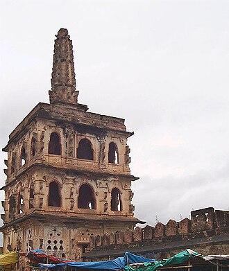 Banashankari Amma Temple - The Guard tower cum Deepa Stamba (lamp tower) on the bank of the water tank in front of the Shakambari temple