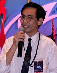 Democracy activist Nguyen Quoc Quan speaking at a Fourth International Vietnamese Youth Conference in Sydney in December 2005.jpg