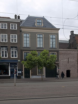Prince William V Gallery - The Gallery is in the top floor of the building on the left, and on the right is the entrance to both gallery and the Museum Gevangenpoort