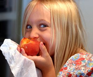 Mouthfeel - A child bites into a peach experiencing a number of sensations including sweetness, juiciness, and a variety of textures, which together constitute what researchers call mouthfeel.