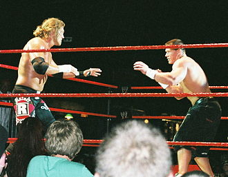 John Cena - Cena facing off against Edge at a WWE house show