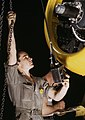 Employee number 30, Mounting motor on a Fairfax B-25 bomber, at North American Aviation, Inc., plant in Inglewood, Calif (cropped).jpg