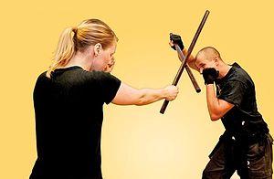 Stick-fighting - Two people fighting using sticks