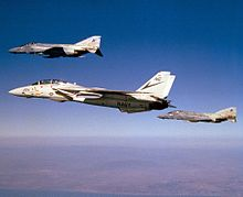 F-14A VF-24 in flight with F-4S VF-301 1986.JPEG