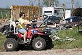 FEMA - 44488 - Oklahoma resident inspecting tornado damage.jpg