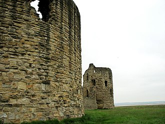 Flint Castle - The massive stone keep, curtain wall and three-storey corner tower.