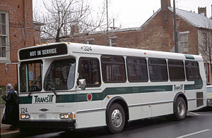 TransIT - Ribbon cutting ceremony for Frederick County's TransIT, first new bus under county management, sits parked at the TransIT services building in 1994.