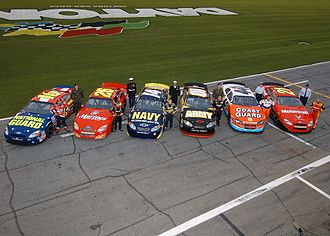 Special paint schemes on racing cars - The military-sponsored cars of six drivers in 2004. From left to right: Greg Biffle (National Guard), Bobby Hamilton Jr. (Marines), Casey Atwood (Navy), Joe Nemechek (Army), Justin Labonte (Coast Guard), Ricky Rudd (Air Force)
