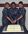 From left, U.S. Navy Lt. Peter Ham, Hospital Corpsman 1st Class Asterik Knotts and Lt. David Myers, all assigned to the aircraft carrier USS Abraham Lincoln (CVN 72), cut the cake at a celebration in honor 130822-N-YB832-019.jpg