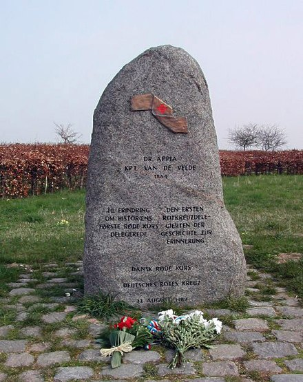 Memorial commemorating the first use of the Red Cross symbol in an armed conflict during the Battle of Dybbol (Denmark) in 1864; jointly erected in 1989 by the national Red Cross societies of Denmark and Germany. Gedenkstein-rotes-kreuz-1864.jpg
