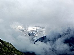 Glimpse of Nanda Devi amidst the clouds from Valley of Flowers.jpg