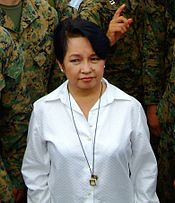 Gloria Arroyo flanked by United States Marines.
