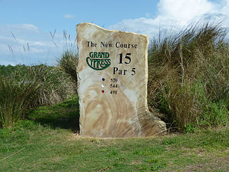 A marker stone indicating that this hole is a par-5 hole Grand Cypress New Course 15th hole.jpg