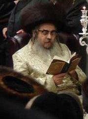 Grand Rabbi Aaron Teitelbaum, Satmar Rebbe, in synagogue, on Hanukkah, in Kiryas Joel, New York State