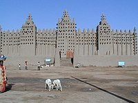 The Great Mosque's signature trio of minarets overlooks the central market of Djenné. Unique Malian aesthetic