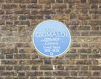 blue plaque commemorating Grimaldi